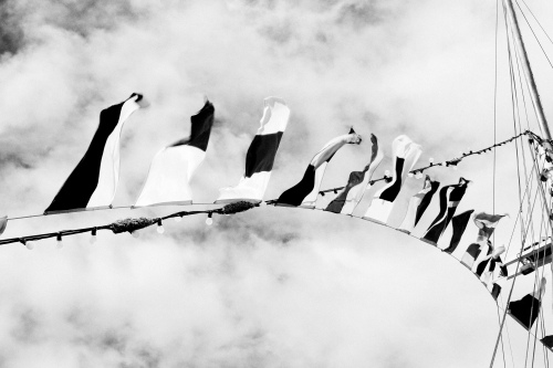 black-and-white-sky-flags-boat